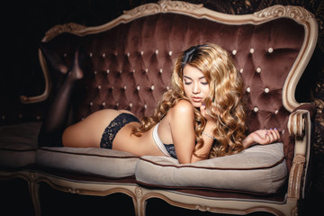 Sexy asian girl in a lingerie with long curved hair
