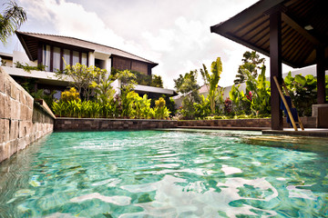 Traditional swimming pool with stone walls
