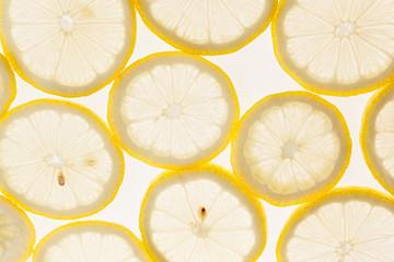 Slices of lemon on a white background. Pattern. Macro. Fruit background.