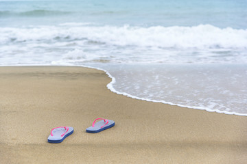 Flip-flops on the beach.
