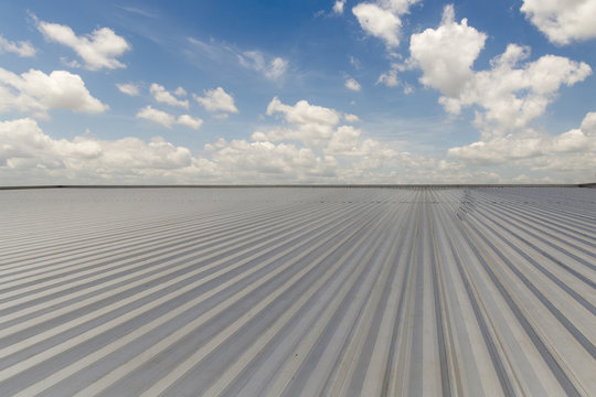 metal sheet roofing on commercial construction with blue sky
