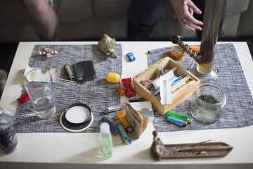 Drug Paraphenalia On Table With Cannabis Leaf