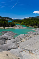 travel to lake barrage of yesa in blue sky, spain