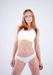 Slim sporty fitness woman in studio