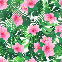Seamless pattern with exotic hibiscus flowers and palm leaves.