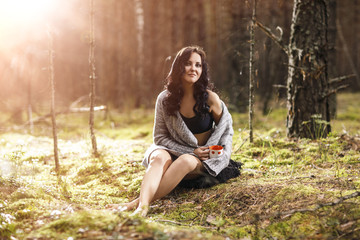 Beautiful woman sitting in the forest