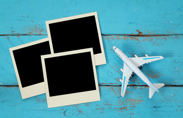 Top view of travel instant photographs next to airplane