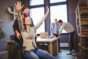 Creative coworkers enjoying in office