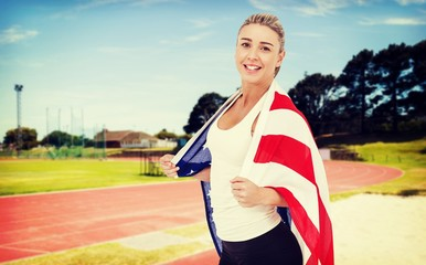 Composite image of female athlete with american flag