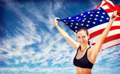 Composite image of portrait of happy sportswoman