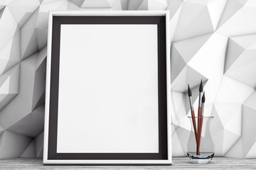 Blank Picture Frame with Brushes in front of Low Polygon Decorat