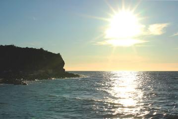 Bright white sun above the sea