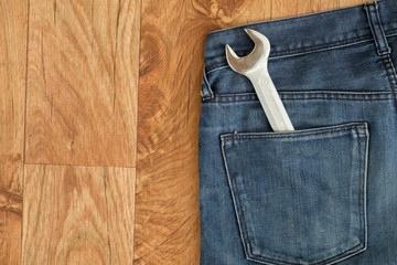 Worker clothes isolated on wooden background