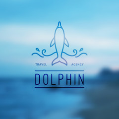 logo of dolphin and waves