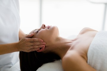 Woman receiving massage from masseur