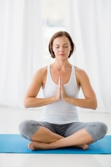 Full length of young woman doing yoga