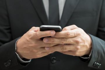Businessman using mobile smartphone