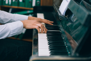 Mans hands playing piano/ selective focus