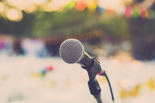 Microphone on outdoor stage. Vintage filter