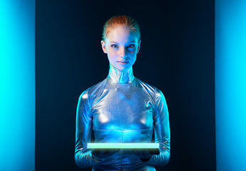Futuristic young woman in silver clothing