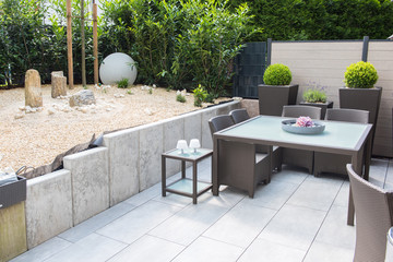 new arranged stone garden with terrace and Table and chairs