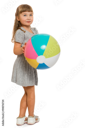 e65655429 Beautiful little blond girl playing with a bouncy ball - Isolated on white  background