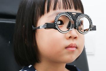 Asian Little Chinese Girl Doing Eyes Examination