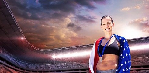 Sporty woman posing and smiling with American flag