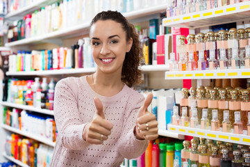 Ordinary female customer posing near shelves