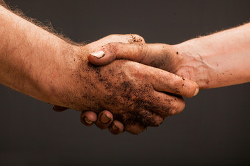 farmers  hand holding soil surface