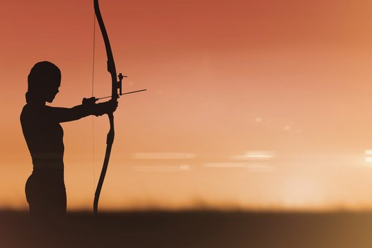 Side view of woman practicing archery