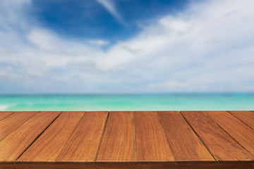 Wood table top on tropical ocean sky background. For display products