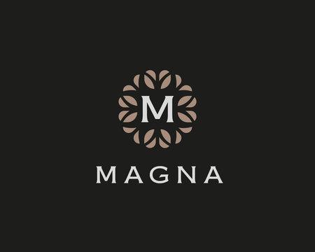 Premium monogram letter M initials logo. Universal symbol icon vector design. Luxury abc leaf logotype.