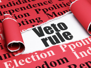 Politics concept: black text Veto Rule under the piece of  torn paper
