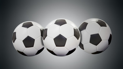 soccer balls isolated on black background