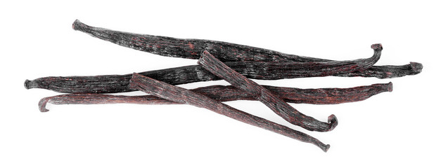 Dried vanilla sticks isolated on white