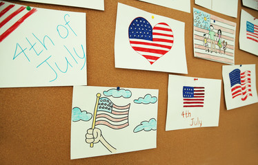 Child's drawings of American flag on cork board