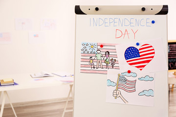 Child's drawings of American flag on flip chart