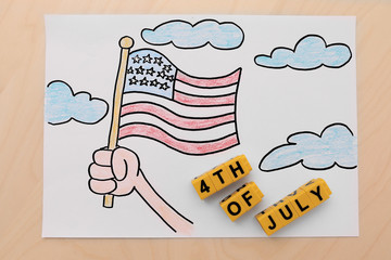 Child's drawing of American flag on paper