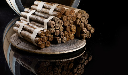 Cuban cigars are handmade, aged several years in a barrel of brandy