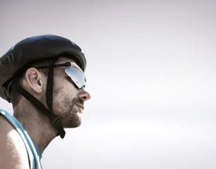 Composite image of man wearing a helmet