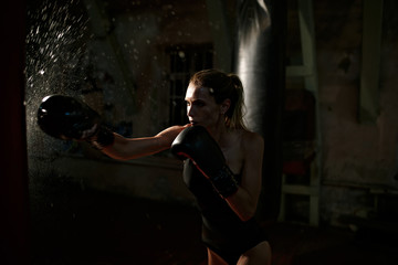 Boxing woman in black body