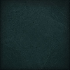 Dark black slate background or texture.