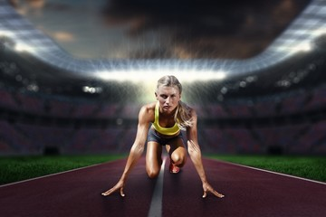 Composite image of sportswoman in the starting block