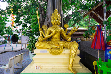 Beautiful big golden Brahma statue under a tree in Thailand temple