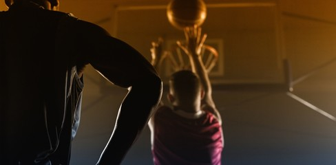 Rear view of a player shooting a basketball