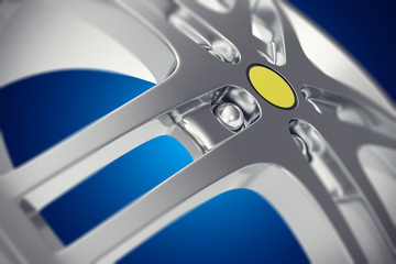 Car rim close-up view with depth of field effect on blue background. 3d illustration