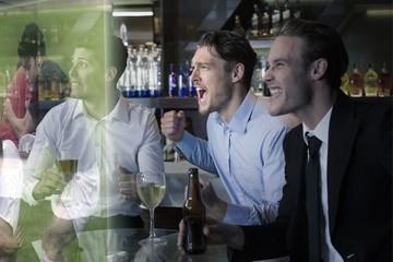 Composite image of handsome friends having a drink together