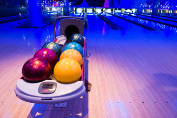 Colorful bowling balls in beautiful light indoor