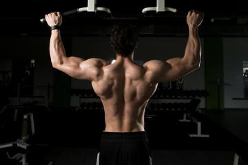 Male Bodybuilding Athlete Doing Pull Ups